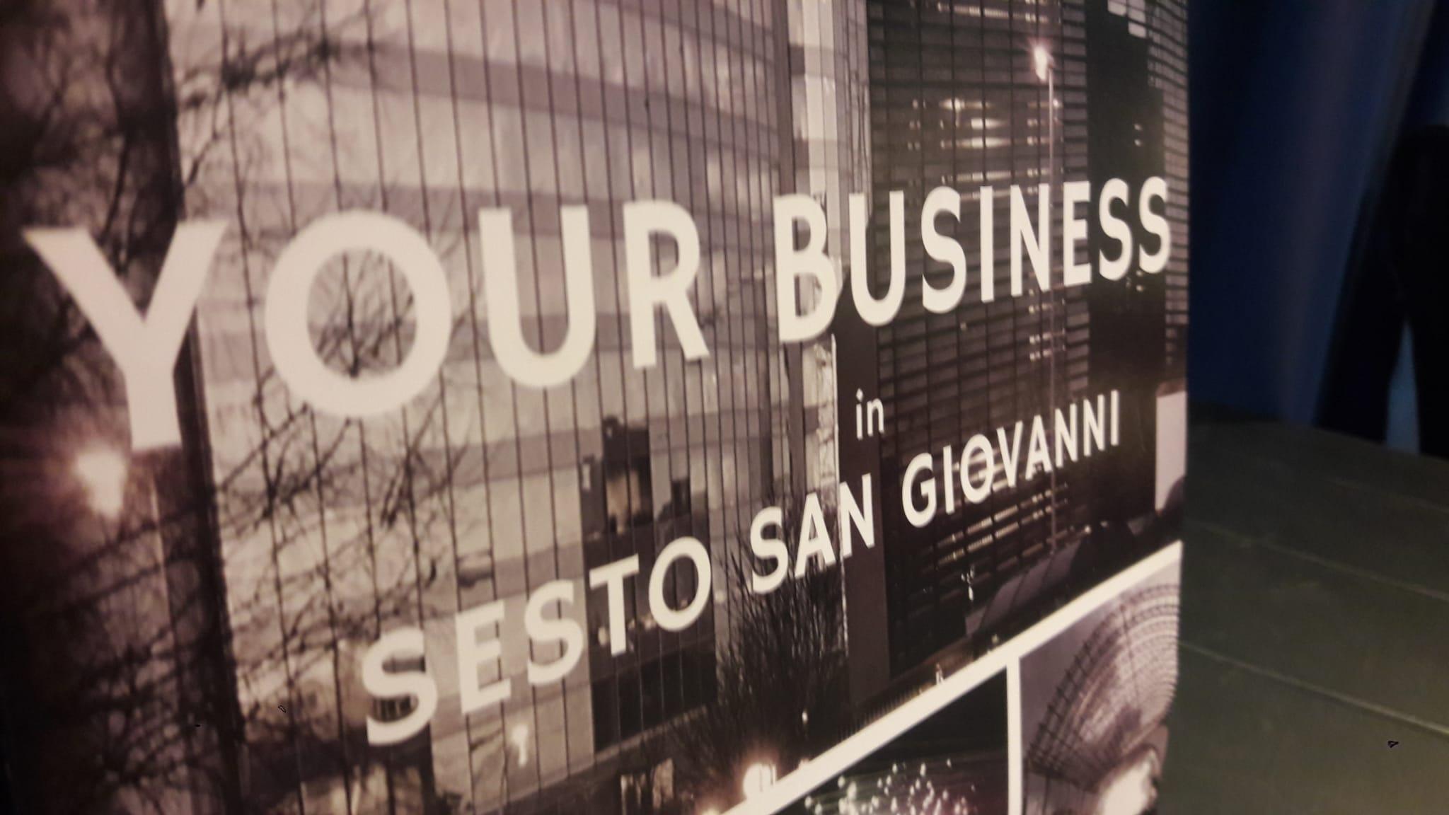 scritta your business in Sesto San Giovanni